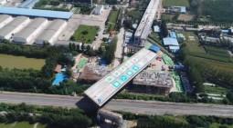 2.2萬噸!董梁高速寧梁段上跨京九鐵路轉體橋成功轉體!
